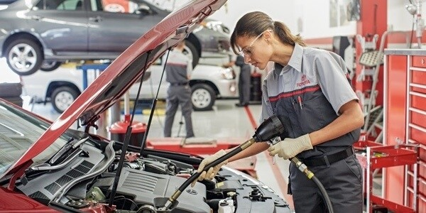 Certified Toyota Technician working on vehicle