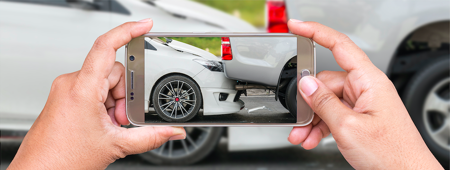 image of phone taking picture of car in accident