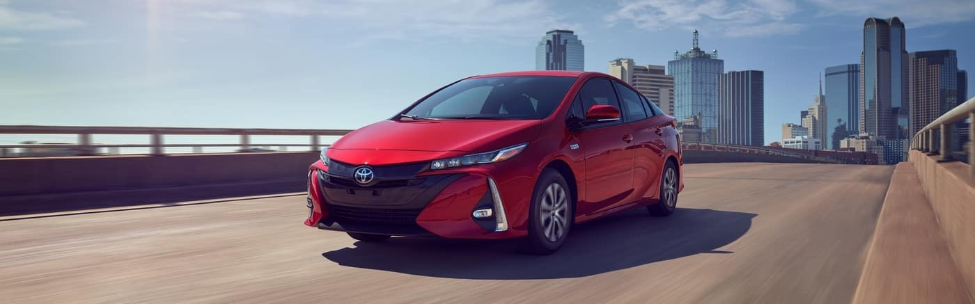 2020 Red Toyota Prius driving on road