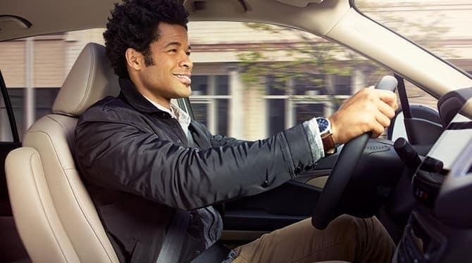Man Driving Honda Pilot