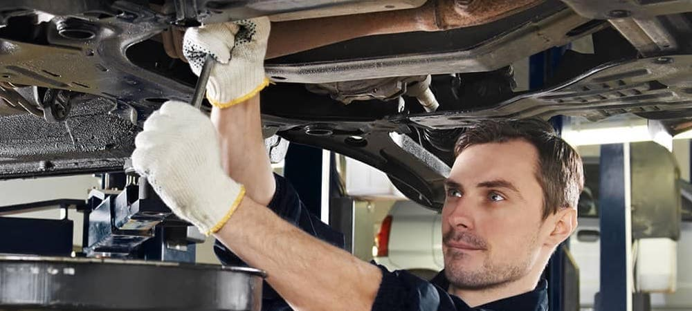 Man performing service under car