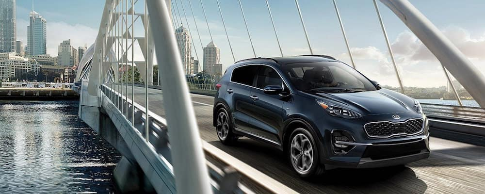Kia Sportage driving on a bridge