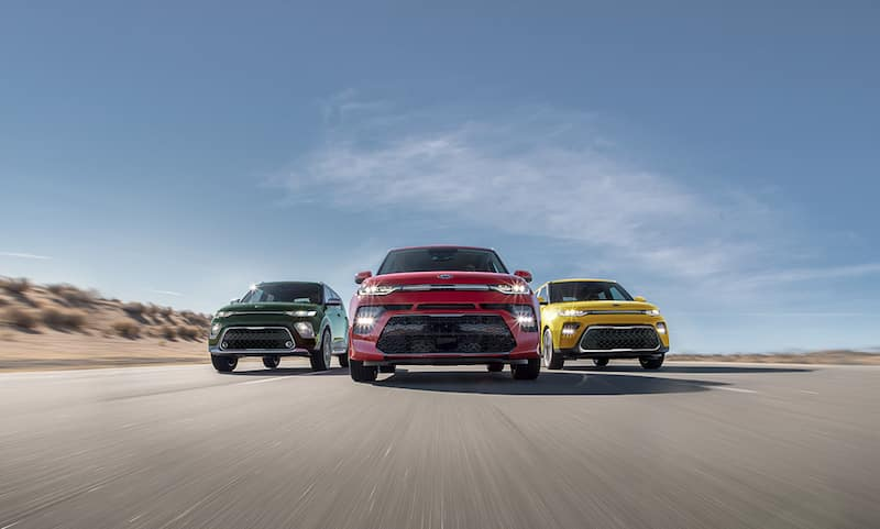 Kia Soul models driving forward in a desert