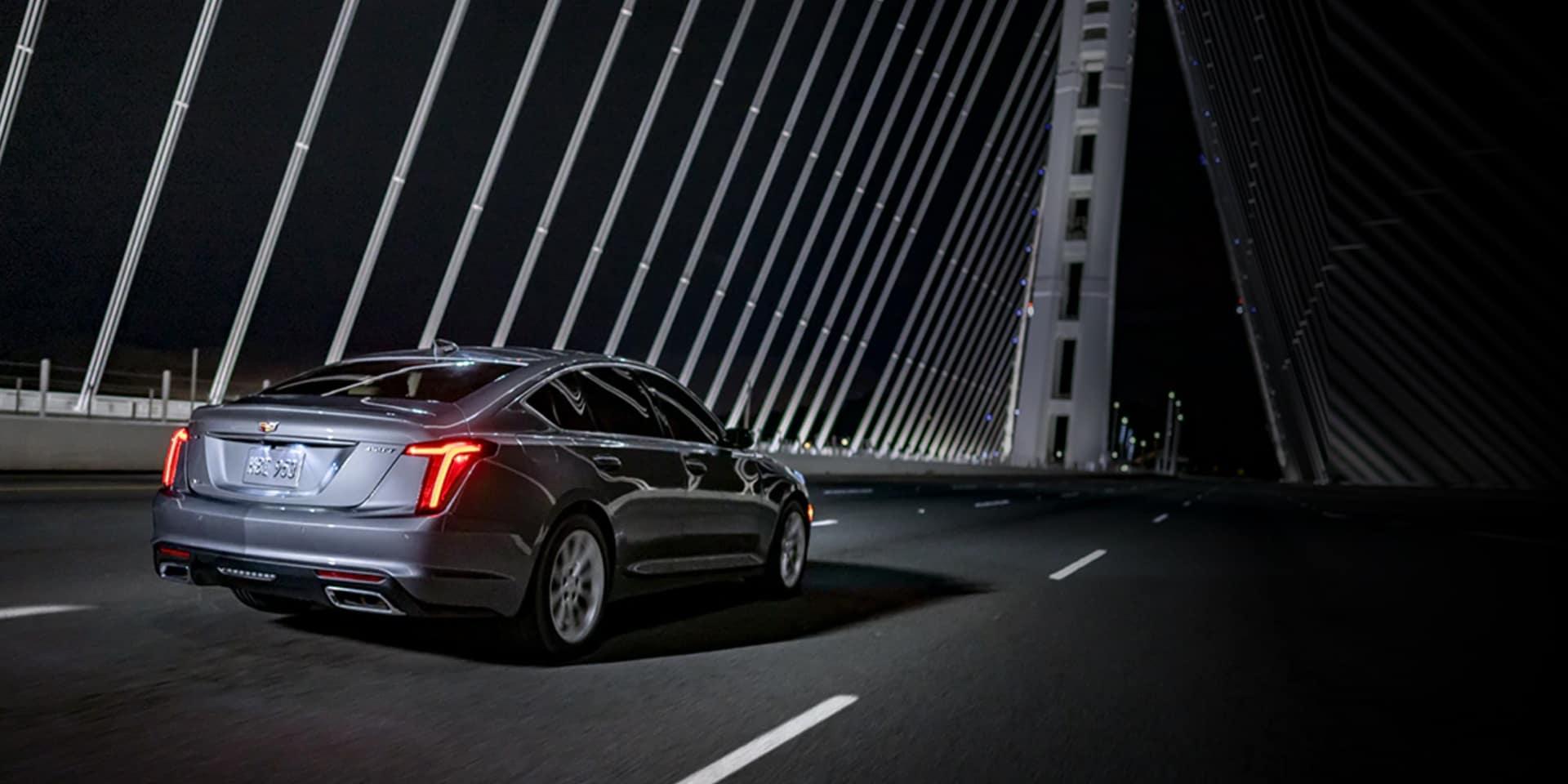Cadillac vehicle on bridge