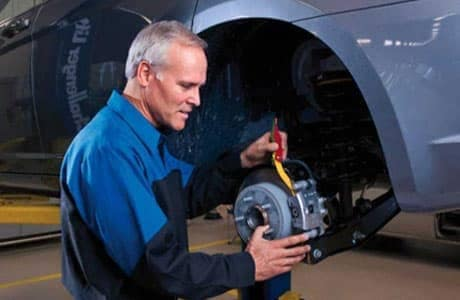 service technician working on brakes