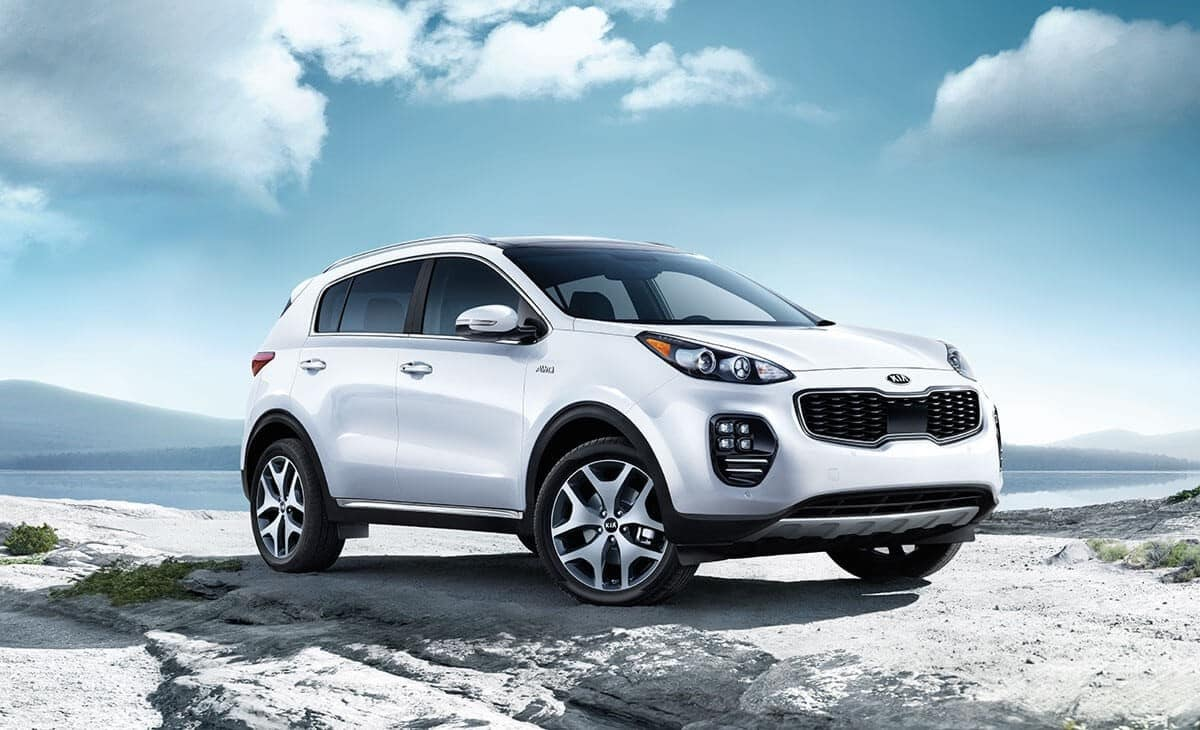 2018 Kia Sportage in a wind-swept, blue skied desert