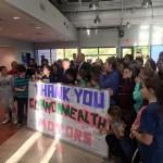 Community Holding Sign
