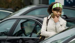 A woman looking at cars