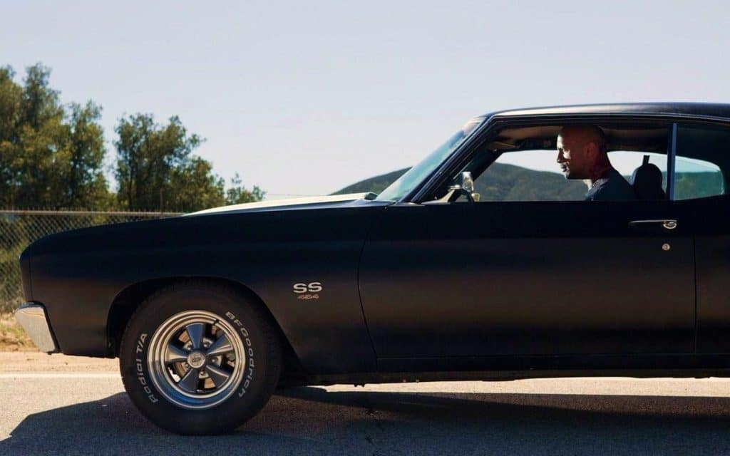 Dwayne Johnson riding the muscle car Chevelle