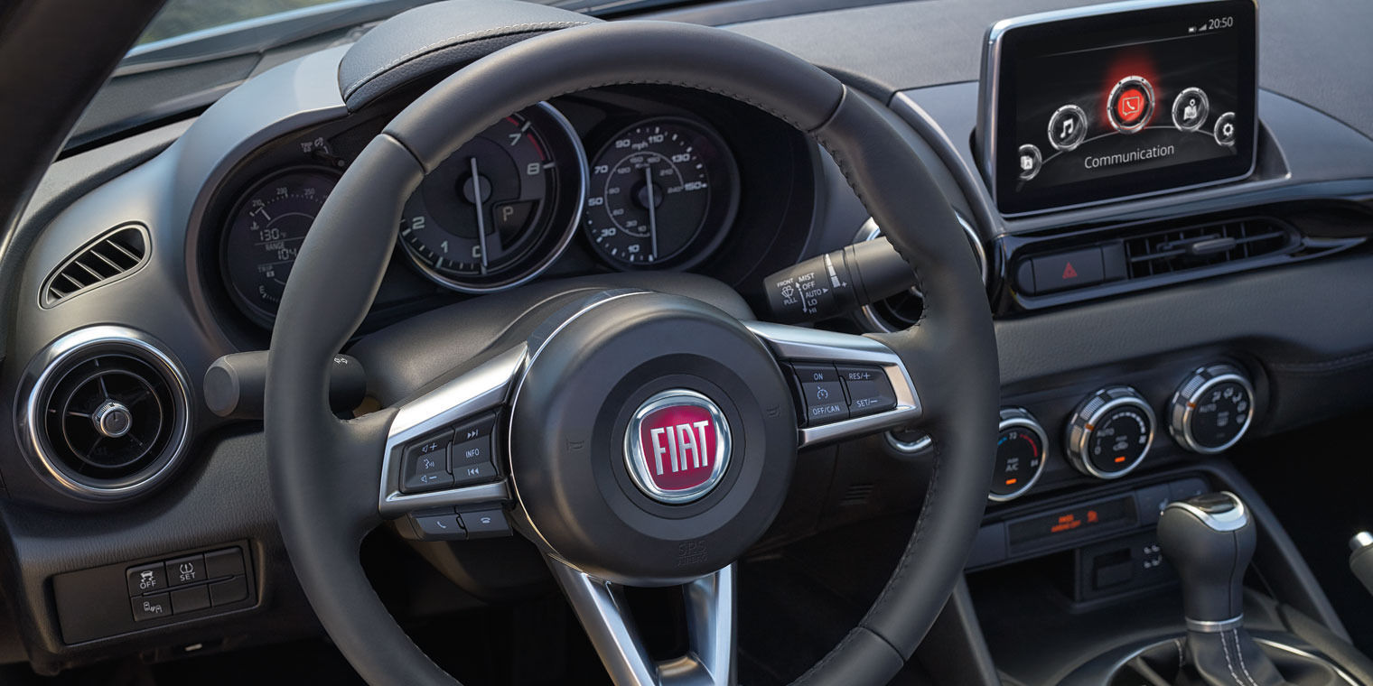 Driver's Wheel View of FIAT Spider Dark Interior