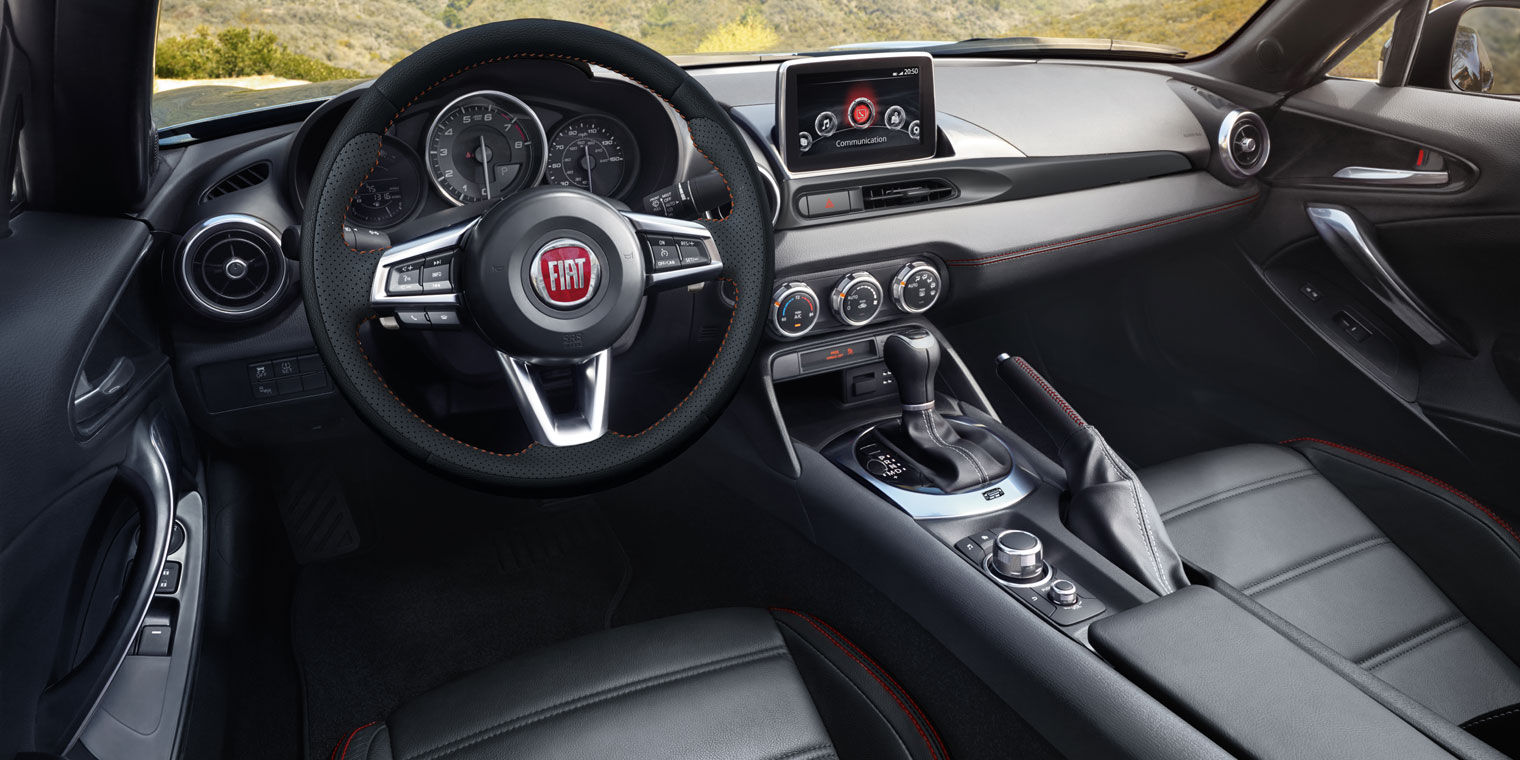 Dashboard View of FIAT Spider Dark Interior