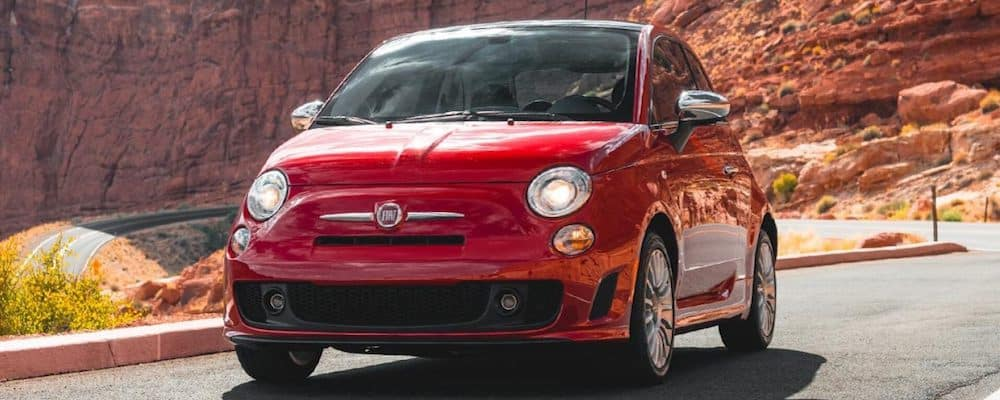 Red FIAT 500 on the road