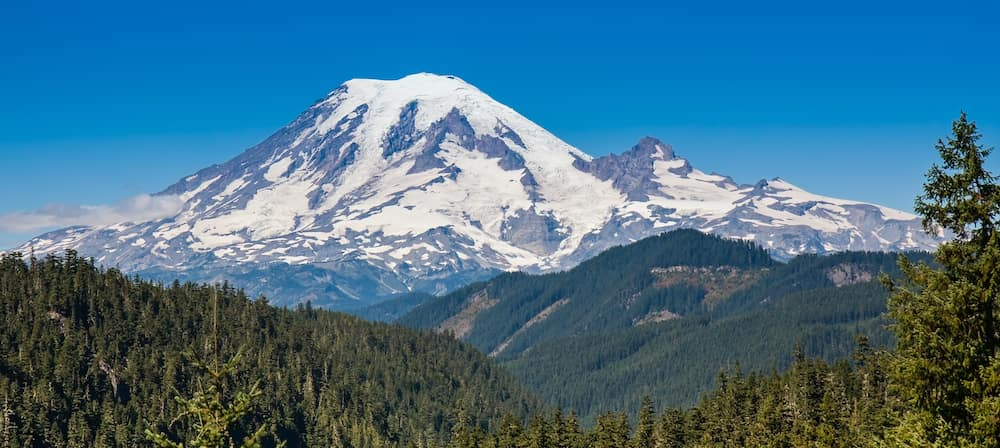 Mount Rainier towering over other mountains