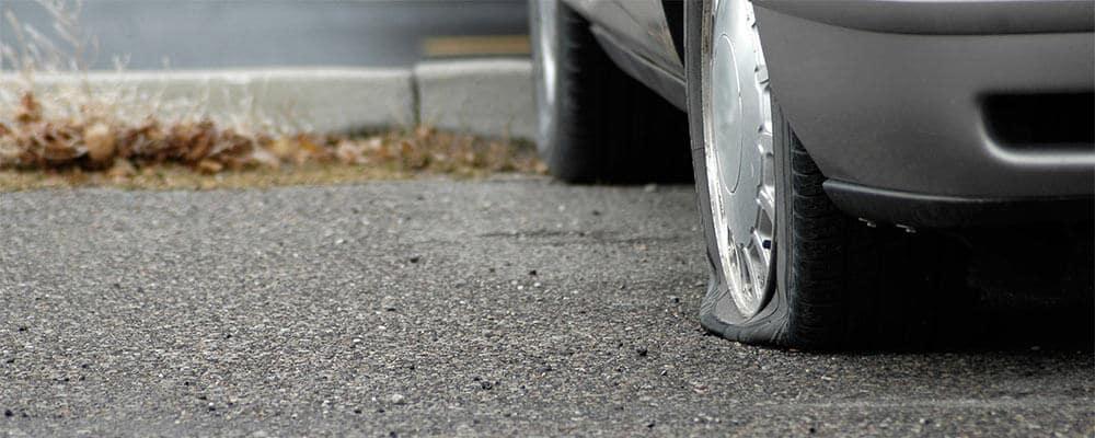 Flat Tire in Parking Lot
