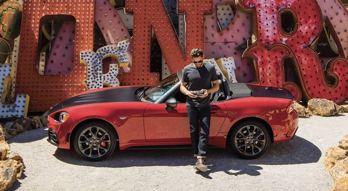 Man standing beside 2019 FIAT 124 Spider