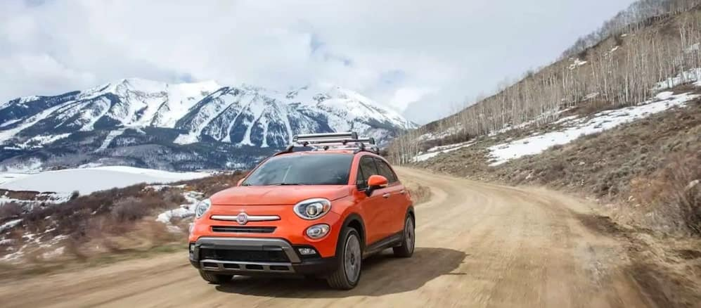 Orange 2018 FIAT 500X Driving Through Valley