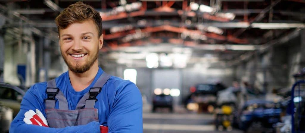 Cheerful serviceman in a car workshop 91820782 original