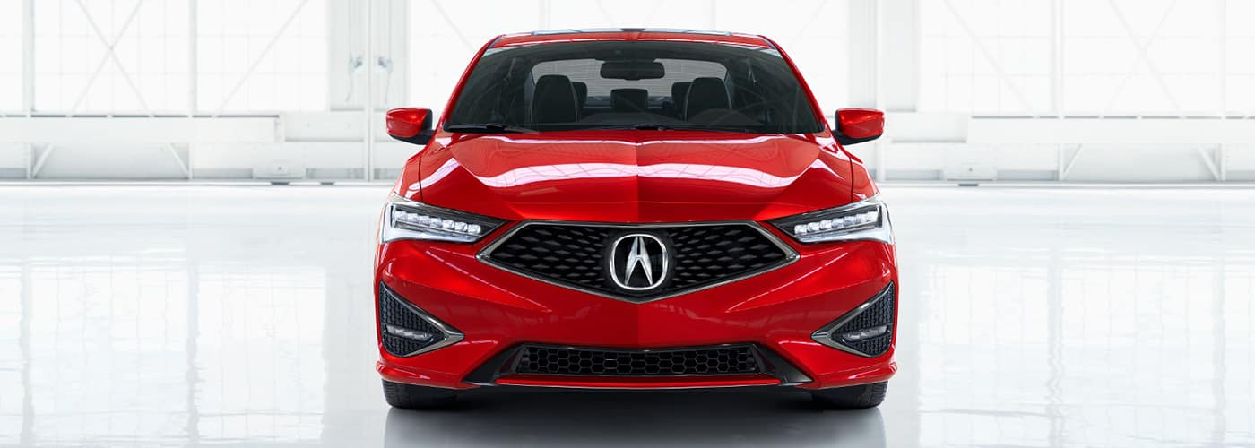 front of a red acura ilx