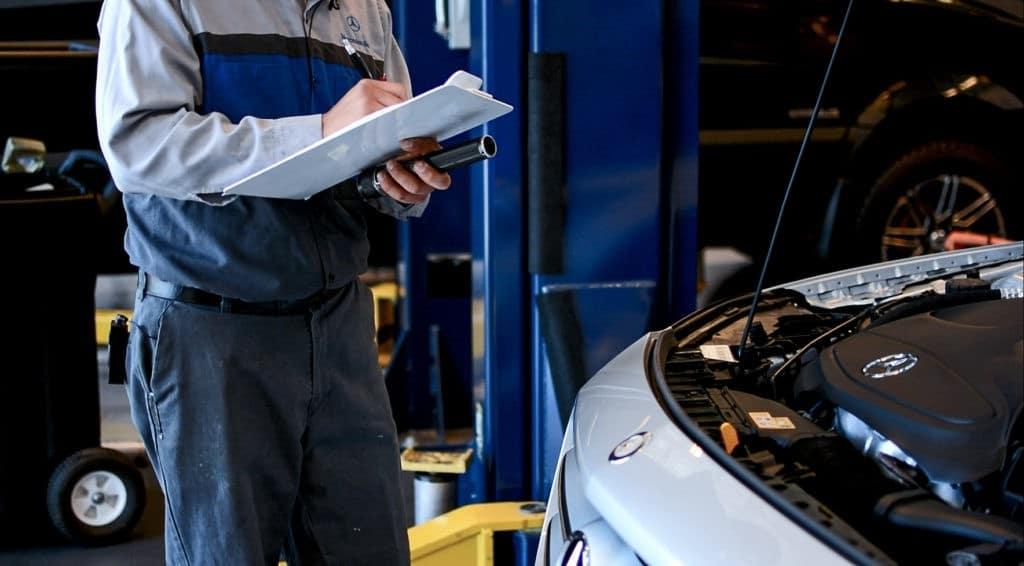 Technician Inspecting Mercedes-Benz