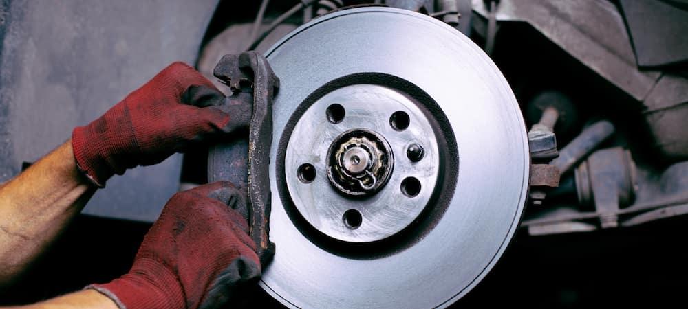 Technician changing brake pads