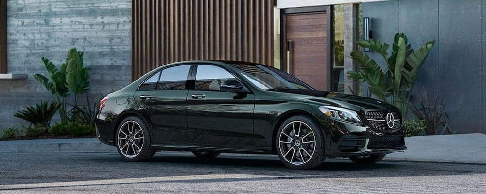 Green 2020 Mercedes-Benz C-Class Sedan parked in front of a building