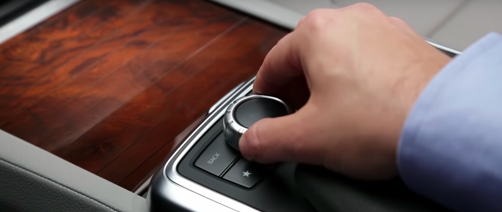 Hand operating a COMAND Controller inside a Mercedes-Benz