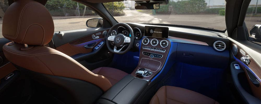 Front seats and dashboard of 2020 C-Class from front passenger side view
