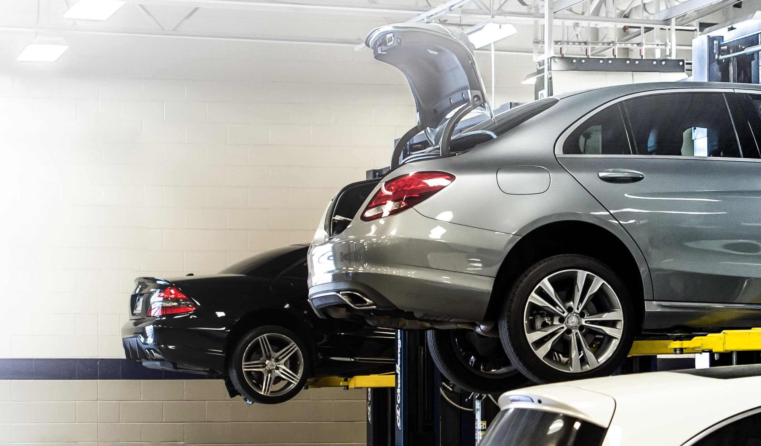 Mercedes-Benz on a lift in shop