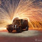 Mercedes-Ben G-Class with Fireworks Behind It