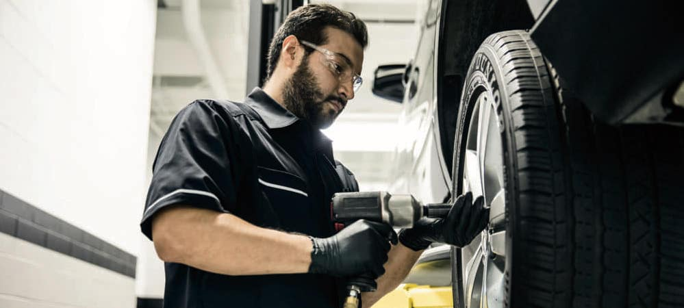 Mercedes-Benz technician working on wheel