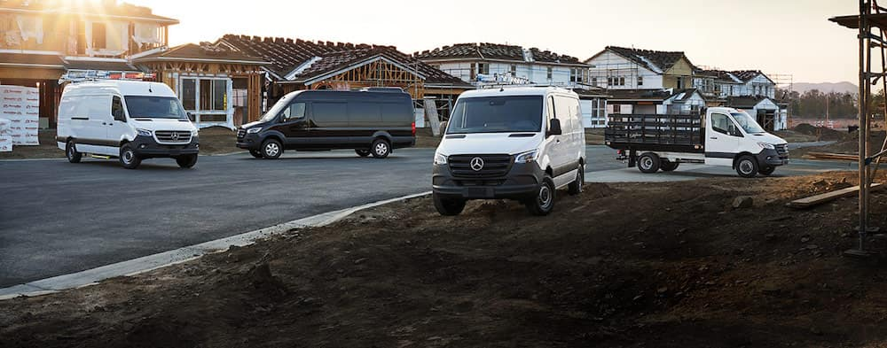 Assortment of different Mercedes-Benz vans parked at jobsite