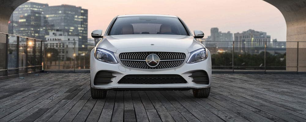 Head-on view of parked white C-Class Sedan