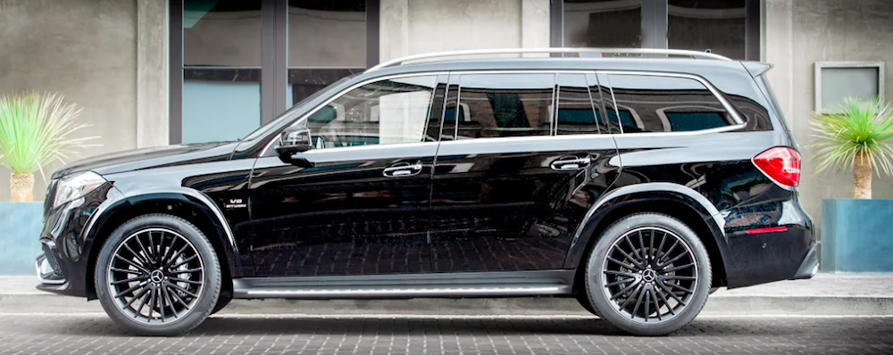 Profile of black Mercedes-Benz SUV parked on city street