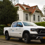 White Ram 1500 Truck parked outside a suburban house