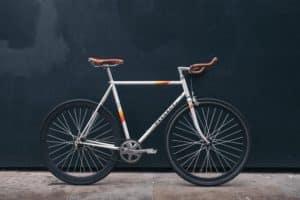Peugeot bicycle upright on sidewalk