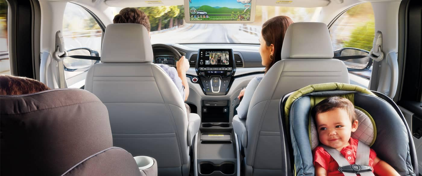 Interior view of family driving in 2018 Honda Odyssey