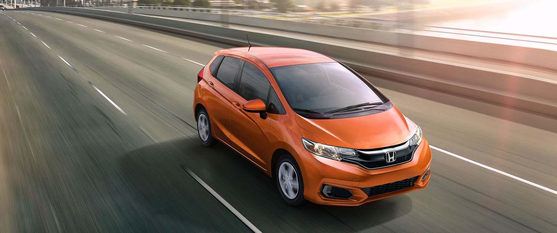 2019 Honda Fit driving on the highway
