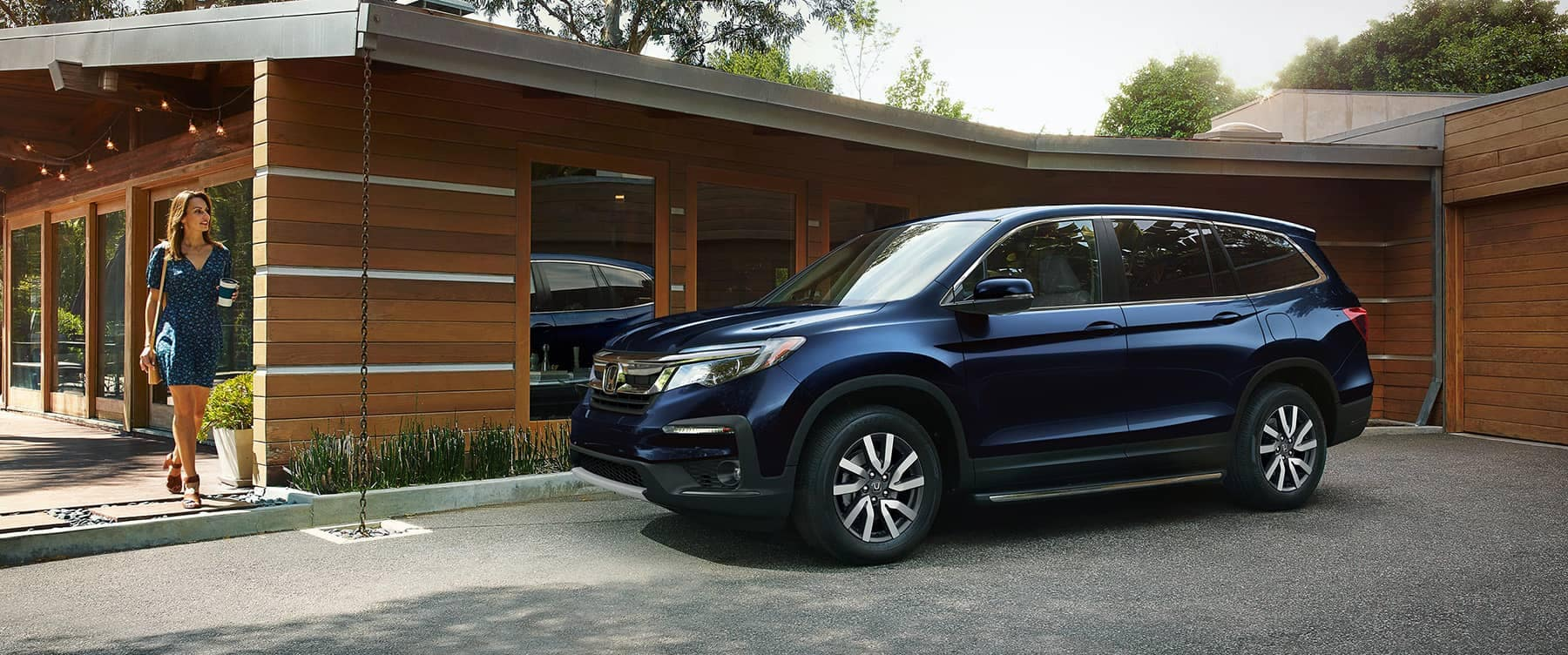 2019 Honda Pilot Parked in Front of Home