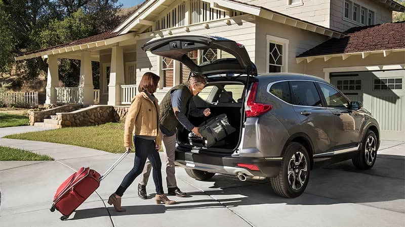 Couple Loading Luggage into 2019 Honda CR-V