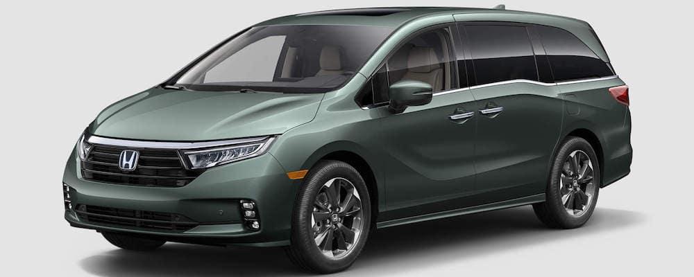 Olive green 2021 Honda Odyssey minivan on white background