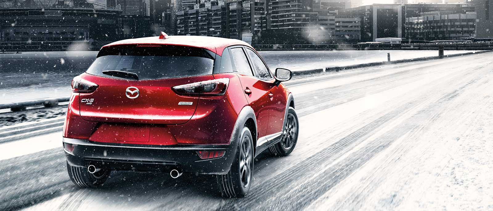 2017 Mazda CX-3 rear view in red