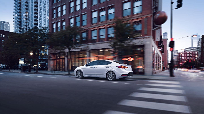 2020 Hyundai Elantra driving past building