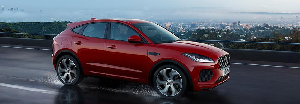 2018 Jaguar E-PACE First Edition driving through rain banner