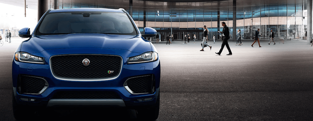 2019 Jaguar F-PACE near crowd of people