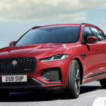 The 2021 Jaguar F-Pace driving on the highway.