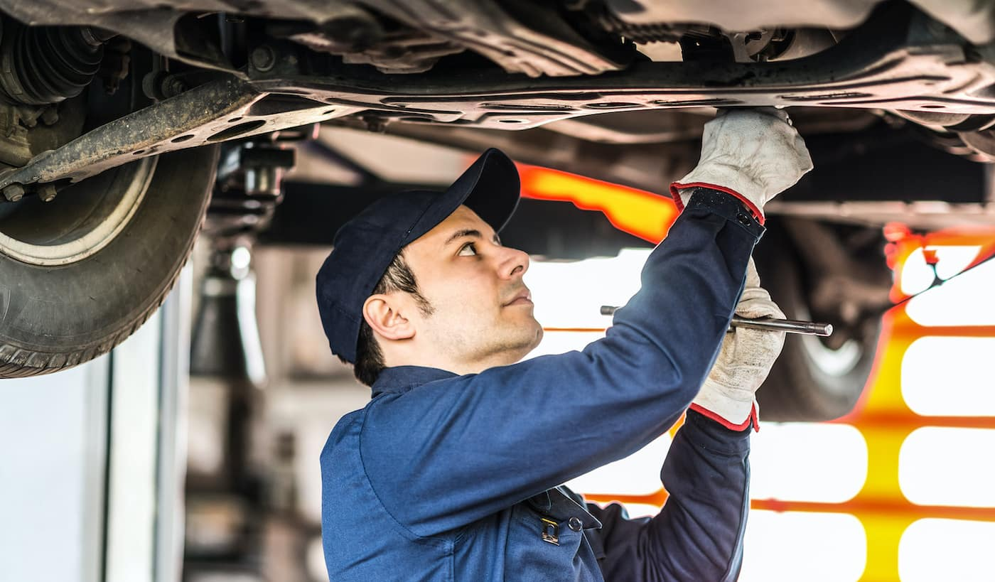 Mechanic working on a catalytic converter.