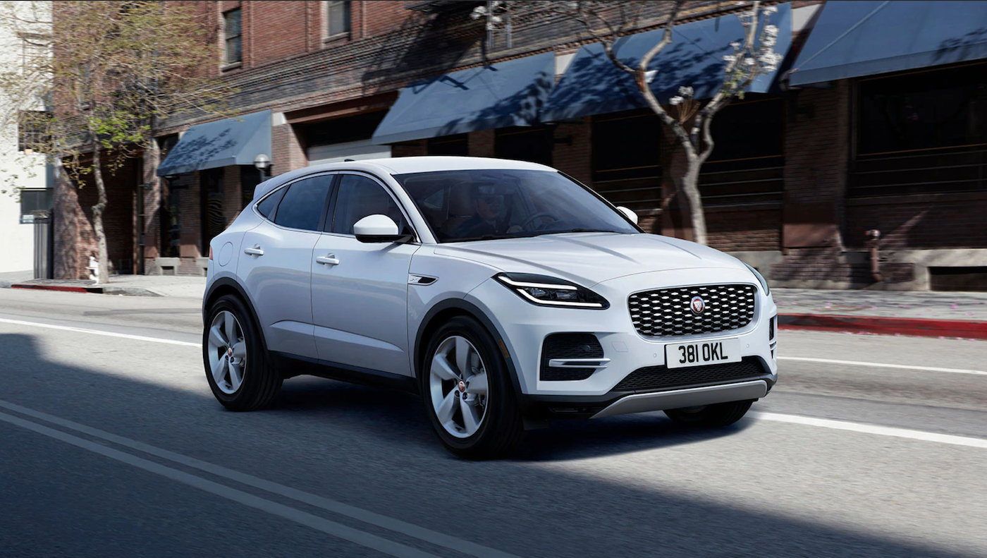 The 2021 Jaguar E-Pace driving down the street.