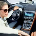 A woman backing up in the 2021 Jaguar F-Type available near Bellmore.