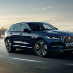 A 2021 Jaguar F-Pace driving on a turn.