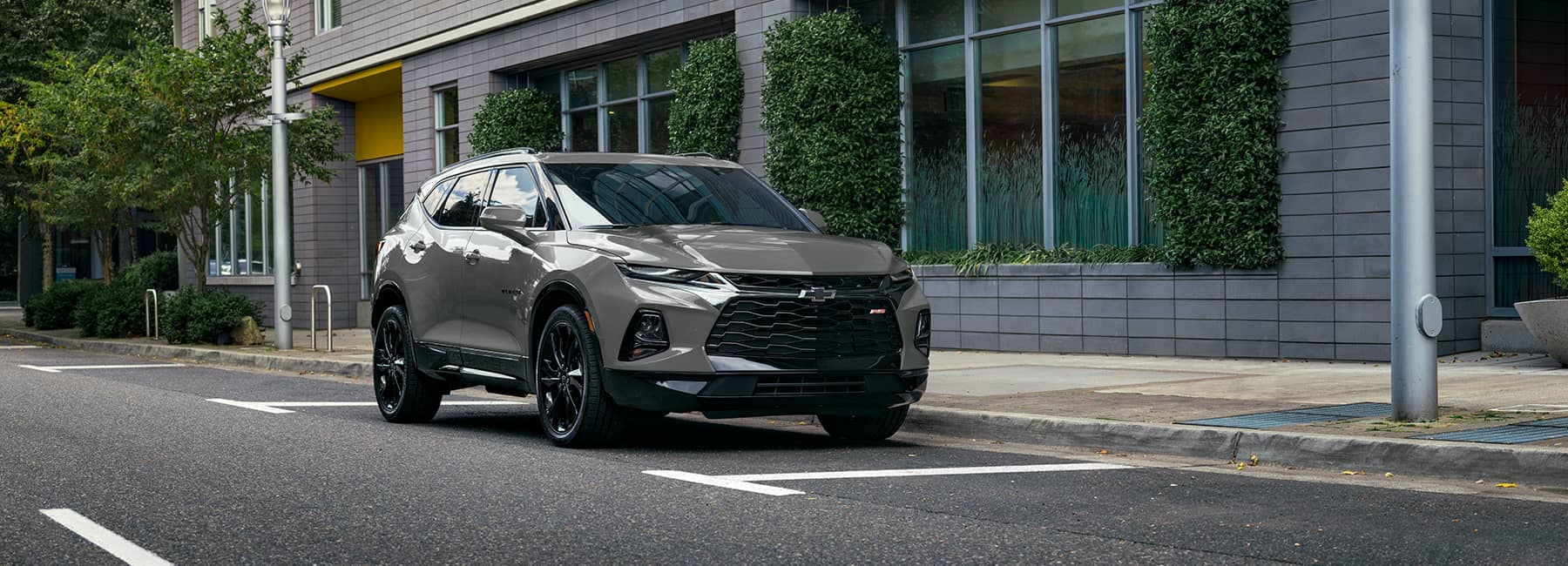 2021 Chevrolet Blazer parked in front of a city building